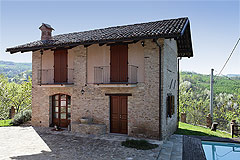 ...elevated position with good views of the surrounding countryside,vineyards and Alps.