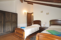 Luxury Property for sale in Piedmont Italy. - Bedroom with exposed wooden beams