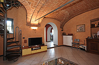 Luxury Home for sale in Italy - Main accommodation - Living area features a vaulted ceilings