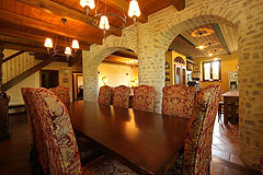 Prestigious Italian villa with Moscato vineyards  for sale in Piedmont. - Dining area with exposed wooden ceiling