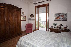 Italian Villa for sale in Piemonte - Master Bedroom leading to balcony