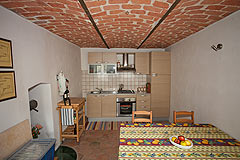 Italian Farmhouse with vineyards for sale in Piemonte - Kitchen with vaulted  ceiling