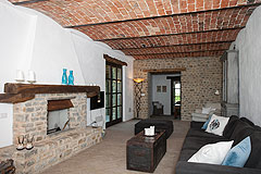 Luxury Country Home with Pool for sale in Piemonte Italy - Living area with vaulted ceiling