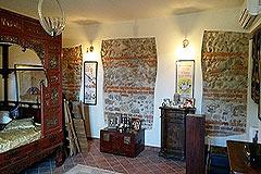 Italian farmhouse for sale in Piemonte - Exposed stone walls in bedroom