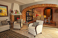 Italian Farmhouse for sale in Piemonte - Living area with exposed brick