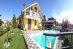 Detached villa in a residential area with large garden and swimming pool. - Pool area