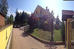 Detached villa in a residential area with large garden and swimming pool. - Driveway